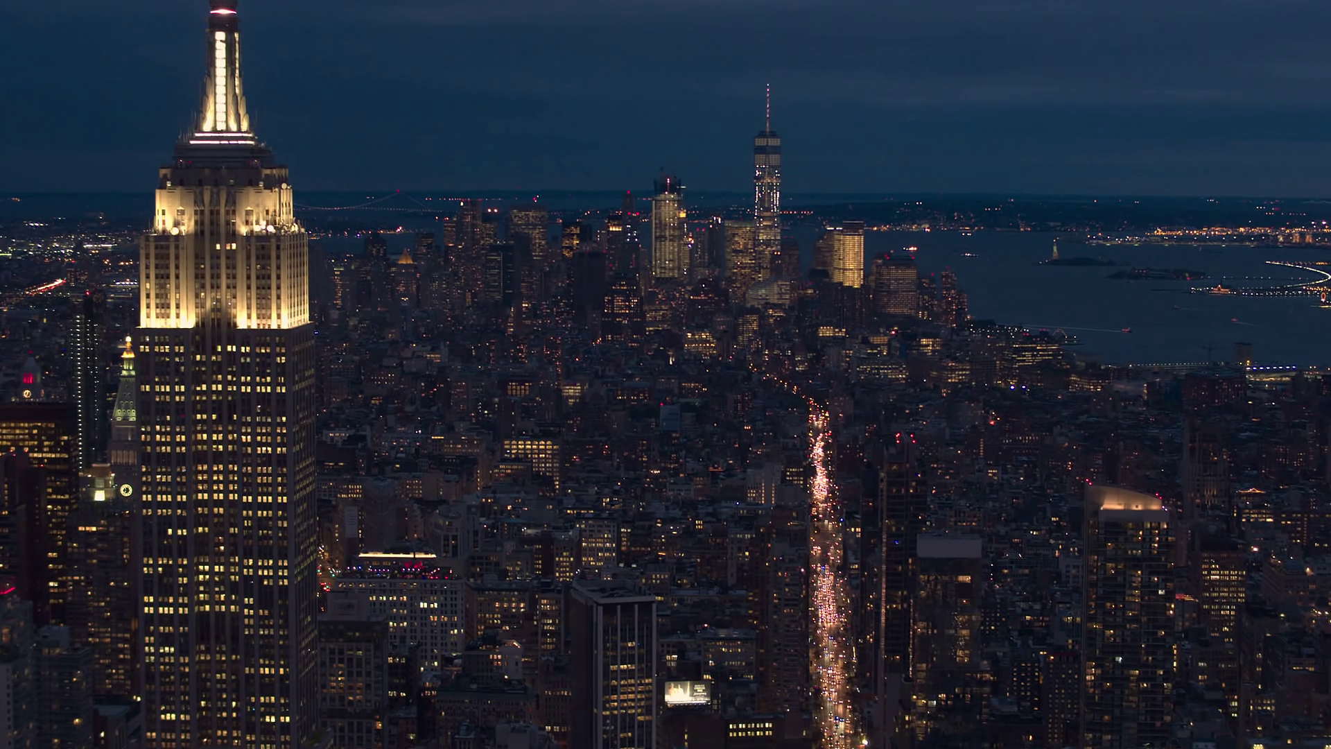 videoblocks-aerial-close-up-city-lights-and-dense-traffic-on-streets-of-new-york-at-night_rfp0cdw9x_thumbnail-full01